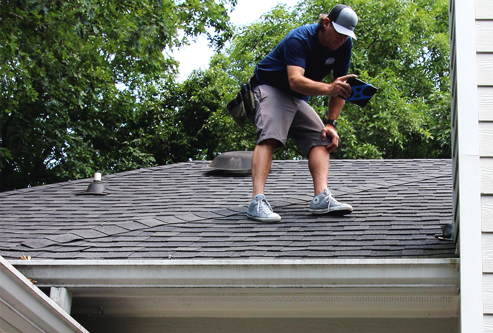Crawford Parish on a roof doing a home inspection